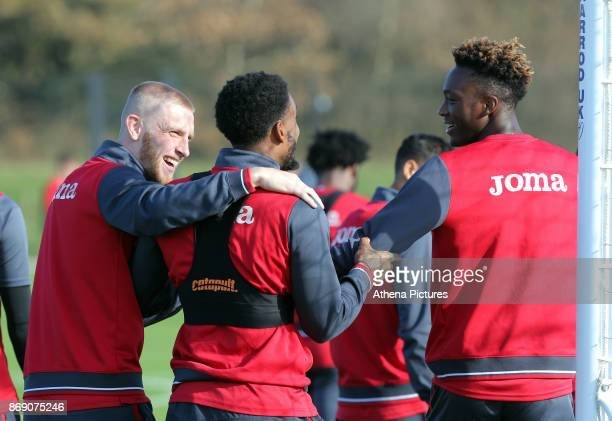 Oliver McBurnie Leroy Fer and Tammy Abraham share a joke while walking to the pitch during the Swansea City Training at The Fairwood Training Ground...