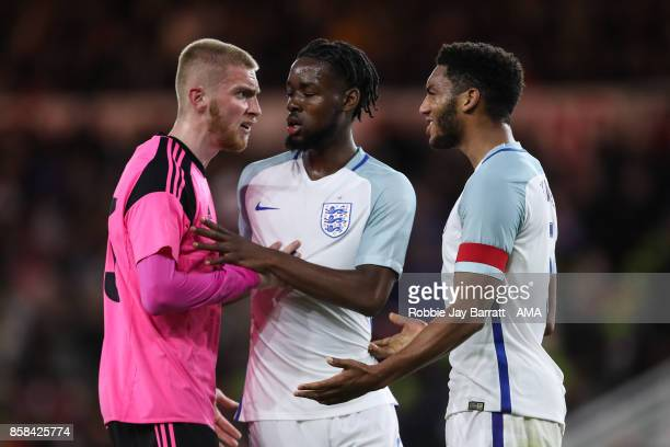 Oliver McBurnie of Scotland U21 Josh Onomah of England U21 and Joe Gomez of England U21 have a disagreement during the UEFA European Under 21...