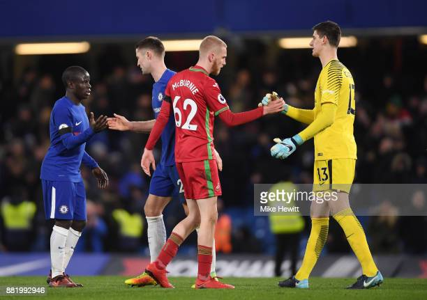 Oliver McBurnie of Swansea City and Thibaut Courois of Chelsea shake hands after the Premier League match between Chelsea and Swansea City at...