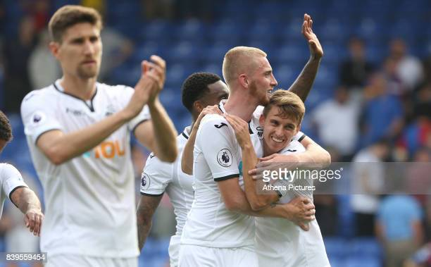 Oliver McBurnie of Swansea City and Tom Carroll of Swansea City celebrate after the final whistle of the Premier League match between Crystal Palace...