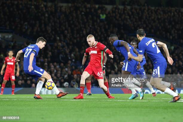 Oliver McBurnie of Swansea City is challenged by Andreas Christensen of Chelsea during the Premier League match between Chelsea and Swansea City at...