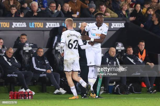 Oliver McBurnie of Swansea City is replaced by Tammy Abraham of Swansea City during dthe Carabao Cup Fourth Round match between Swansea City and...