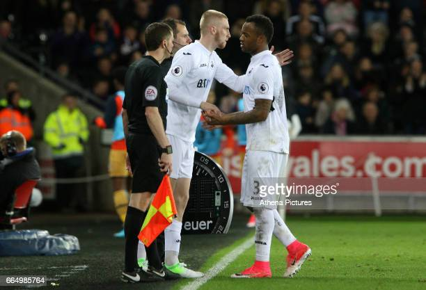 Oliver McBurnie of Swansea City shakes hands with Jordan Ayew of Swansea City during the Premier League match between Swansea City and Tottenham...