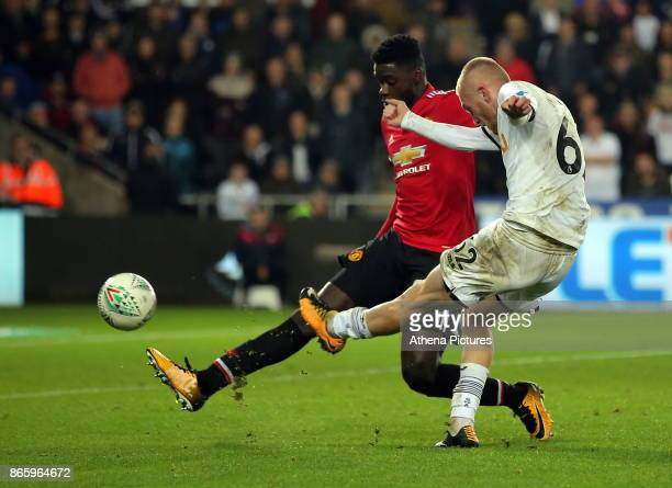Oliver McBurnie of Swansea City takes a shot off target during the Carabao Cup Fourth Round match between Swansea City and Manchester United at The...