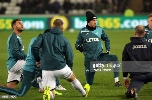 Oliver McBurnie of Swansea City warms up with team mates prior to the Carabao Cup Fourth Round match between Swansea City and Manchester United at...