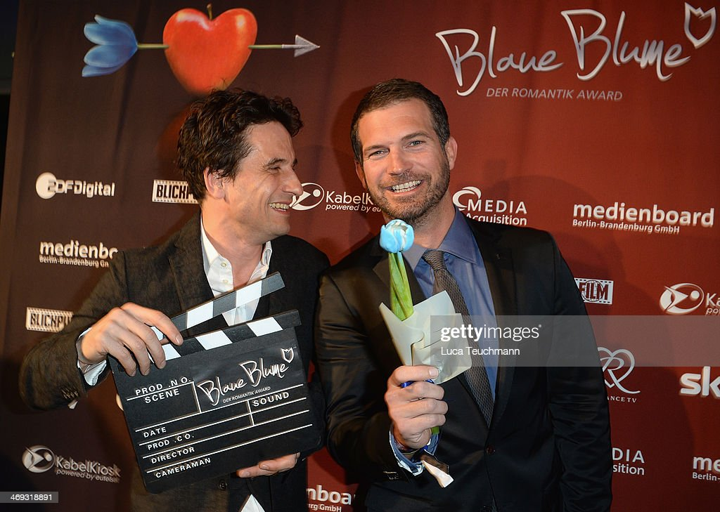 Oliver Mommsen and Simon Boeer attend the Blaue Blume Awards during 64th Berlinale International Film Festival on February 14, 2014 in Berlin, Germany.