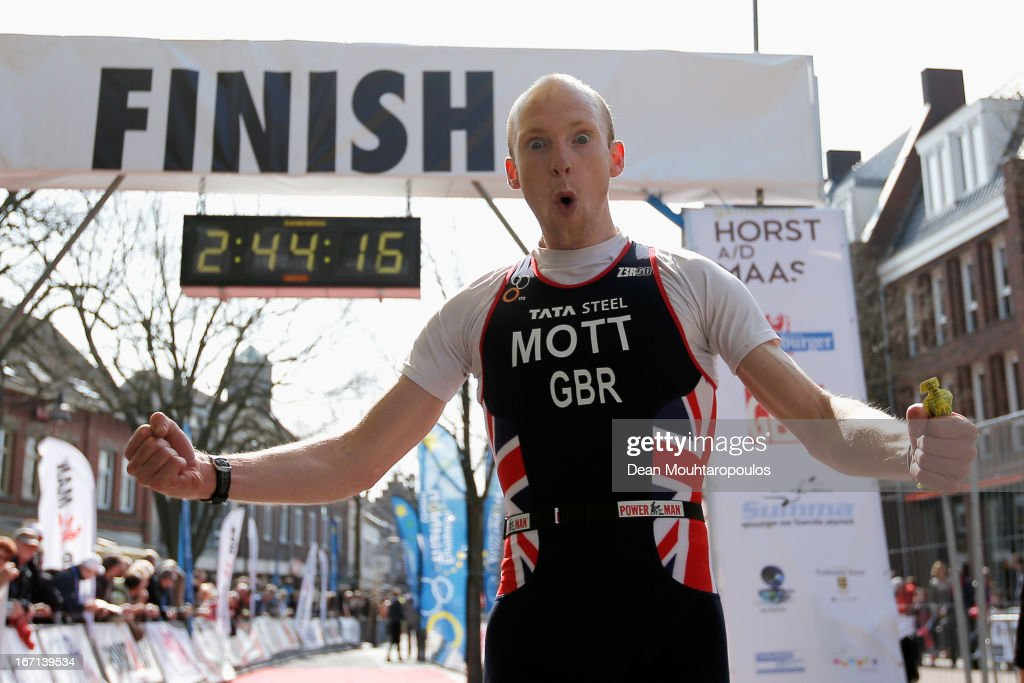 Oliver Mott of Great Britain celebrates as he crosses the finish line in the Elite Mens Long Distance race during the 2013 Horst ETU Powerman Long Distance and Sprint Duathlon European Championships on April 21, 2013 in Horst, Netherlands.