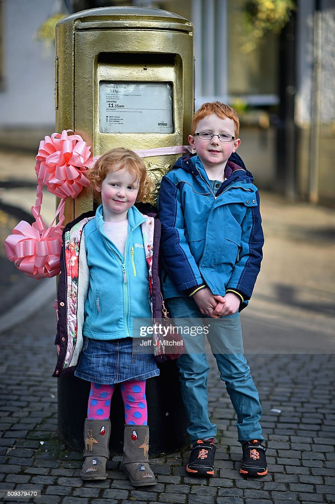 Oliver Mullen aged six and his sister Hannah aged three stand next to the Olympic post box in Andy Murray's hometown of Dunblane where things have been turned pink to celebrate him becoming a dad yesterday for the first time on February 10, 2016 in Dunblane,Scotland. The tennis star's wife, Kim Sears, gave birth to a girl on Sunday morning.