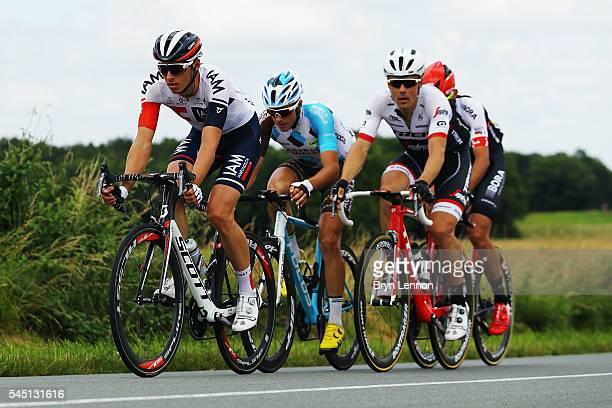Oliver Naesen of Belgium and IAM Cycling Alexis Gougeard of France and AG2RLa Mondiale Markel Irizar of Spain and TrekSegafredo and Andreas...