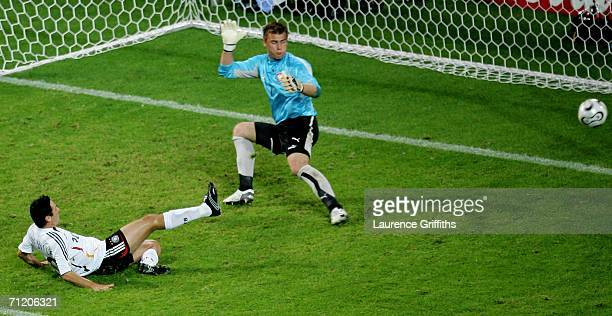 Oliver Neuville of Germany scores the winning goal as Artur Boruc of Poland fails to save during the FIFA World Cup Germany 2006 Group A match...