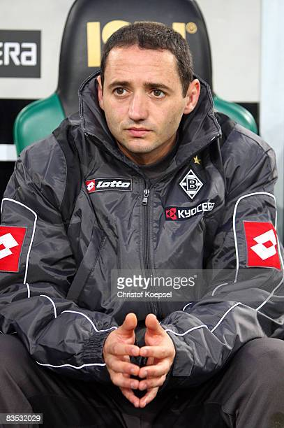 Oliver Neuville of Moenchengladbach looks dejected sitting on the bench during the Bundesliga match between Borussia Moenchengladbach and Eintracht...