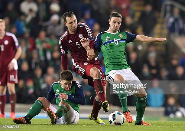 Oliver Norwood and Chris Baird of Northern Ireland and Olegs Laizans of Latvia during the international football friendly match between Northern...