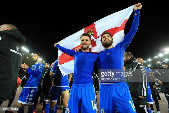 Oliver Norwood and Stuart Dallas of Northern Ireland celebrate after the UEFA EURO 2016 Qualifying match between Finland and Northern Ireland at the...