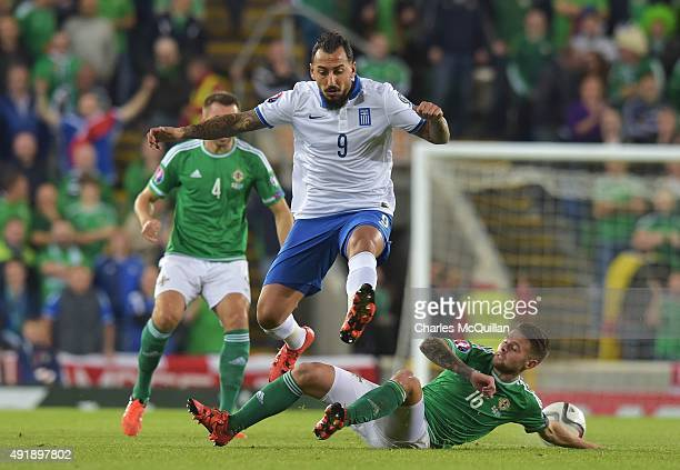Oliver Norwood of Northern Ireland and Kostas Mitroglou of Greece during the Euro 2016 Group F international football match at Windsor Park on...