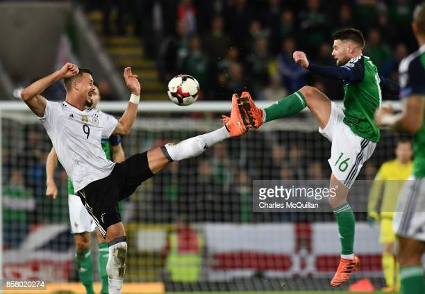 Oliver Norwood of Northern Ireland and Sebastian Rudy of Germany during the FIFA 2018 World Cup Qualifier between Northern Ireland and Germany at...