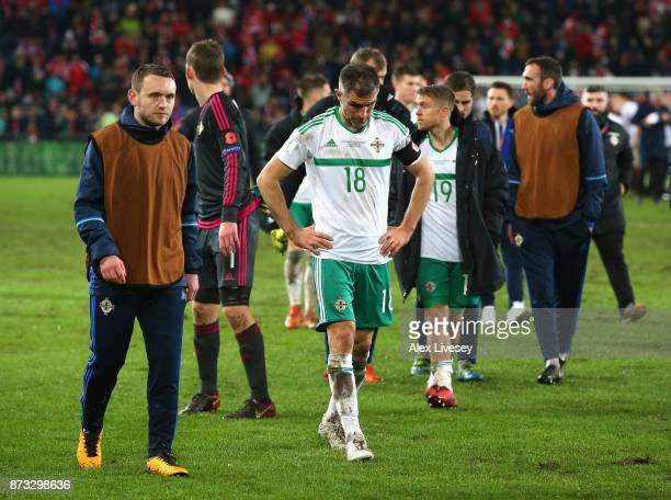 Oliver Norwood of Northern Ireland and team mates look dejected following the FIFA 2018 World Cup Qualifier PlayOff Second Leg between Switzerland...