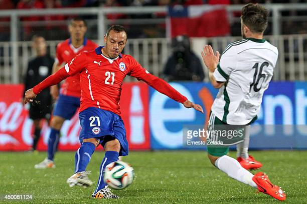 Oliver Norwood of Northern Ireland struggles for the ball with Marcelo Diaz of Chile during the international friendly match between Chile and...