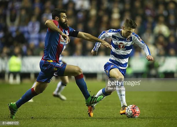 Oliver Norwood of Reading takes on Mile Jedinak of Crystal Palace during the Emirates FA Cup sixth round match between Reading and Crystal Palace at...