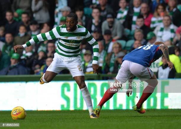 Oliver Ntcham of Celtic is challenged by Chris Casement of Linfield during the UEFA Champions League Qualifying Second Round Second Leg match between...