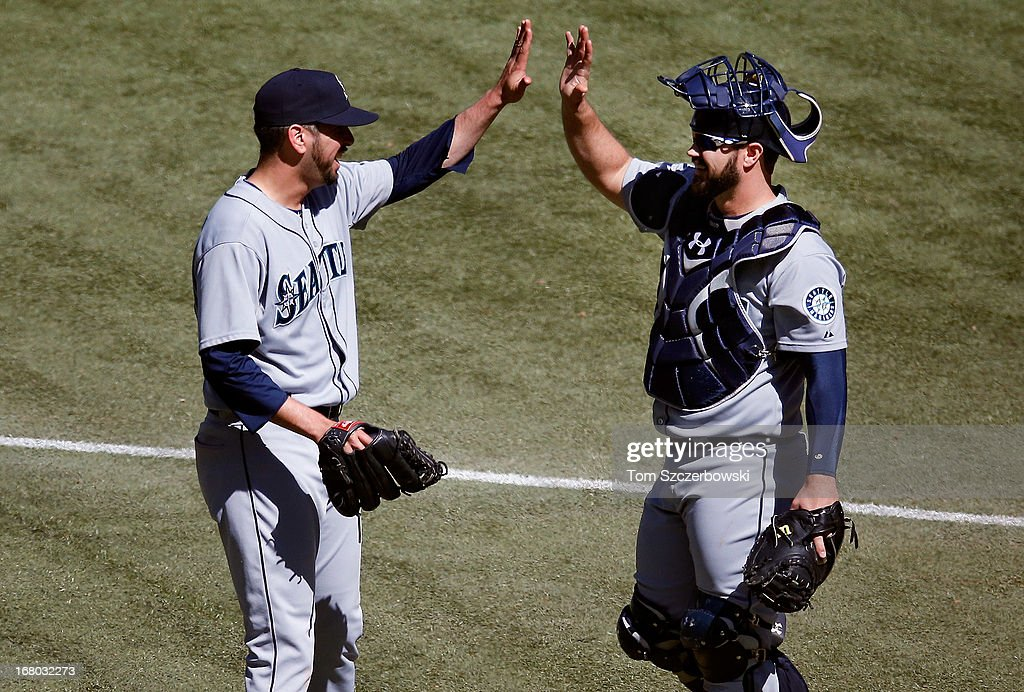 <a gi-track='captionPersonalityLinkClicked' href=/galleries/search?phrase=Oliver+Perez&family=editorial&specificpeople=221389 ng-click='$event.stopPropagation()'>Oliver Perez</a> #59 of the Seattle Mariners celebrates their victory with <a gi-track='captionPersonalityLinkClicked' href=/galleries/search?phrase=Kelly+Shoppach&family=editorial&specificpeople=194967 ng-click='$event.stopPropagation()'>Kelly Shoppach</a> #7 during MLB game action against the Toronto Blue Jays on May 4, 2013 at Rogers Centre in Toronto, Ontario, Canada.