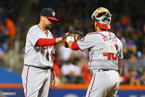 Oliver Perez of the Washington Nationals highfives Wilson Ramos after getting Curtis Granderson of the New York Mets to line out to short with...