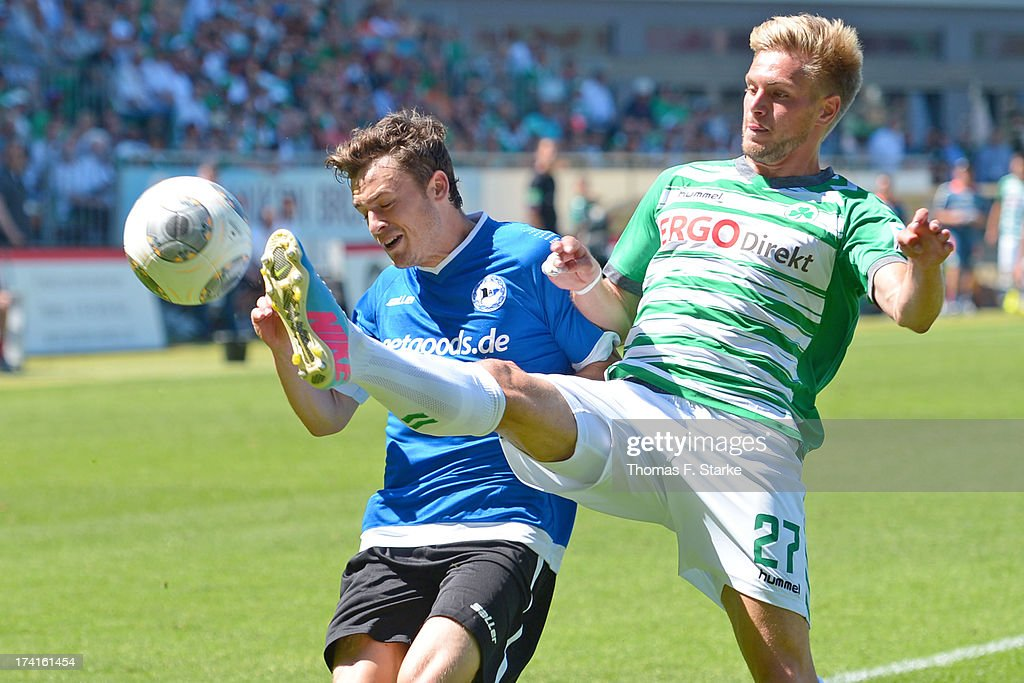 Oliver Petersch (L) of Bielefeld and <a gi-track='captionPersonalityLinkClicked' href=/galleries/search?phrase=Florian+Trinks&family=editorial&specificpeople=5528640 ng-click='$event.stopPropagation()'>Florian Trinks</a> of Fuerth fight for the ball during the Second Bundesliga match between Greuther Fuerth and Arminia Bielefeld at the Trolli Arena on July 21, 2013 in Fuerth, Germany.