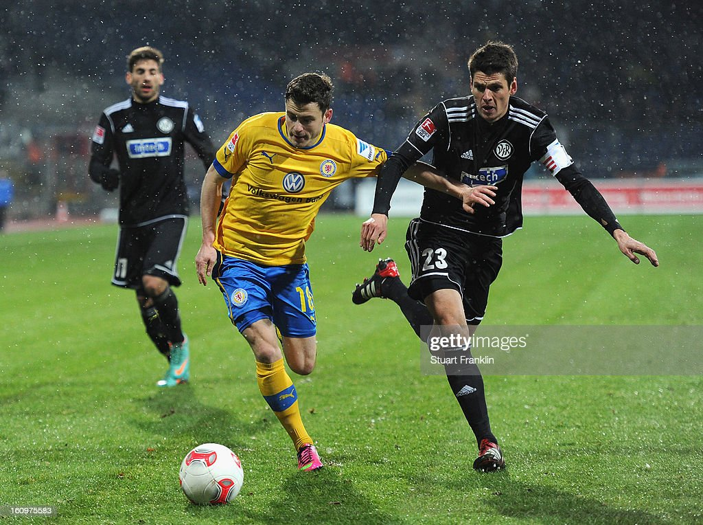 Oliver Petersch of Braunschweig is challenged by Andreas Hoffmann of Aalen during the second Bundesliga match between Eintracht Braunschweig and VfR Aalen at Eintracht Stadion on February 8, 2013 in Braunschweig, Germany.