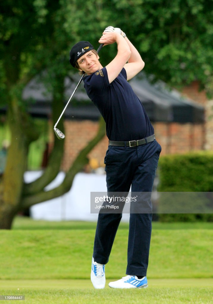 <a gi-track='captionPersonalityLinkClicked' href=/galleries/search?phrase=Oliver+Phelps&family=editorial&specificpeople=810288 ng-click='$event.stopPropagation()'>Oliver Phelps</a> plays a tee shot during the Affinity Real Estate Shooting Stars First Round at The Grove Hotel on June 14, 2013 in Hertford, England.