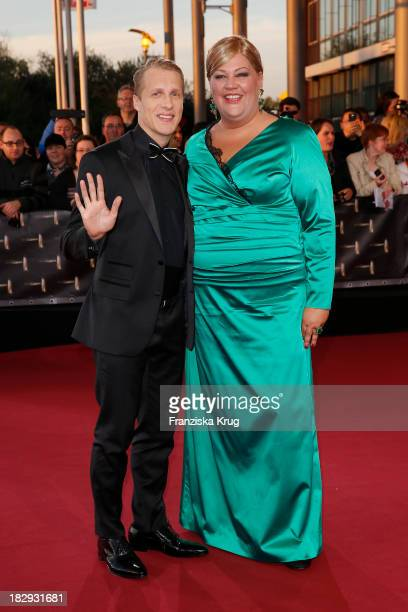 Oliver Pocher and Cindy aus Marzahn attend the Deutscher Fernsehpreis 2013 Red Carpet Arrivals at Coloneum on October 02 2013 in Cologne Germany