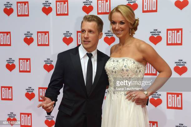 Oliver Pocher and Sabine Lisicki attend the Ein Herz Fuer Kinder Gala 2013 at Flughafen Tempelhof on December 7 2013 in Berlin Germany