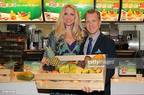 Oliver Pocher and Sonya Kraus attend the presentation of the new Happy Meal with fruits at a McDonald's store on February 26 2014 in Munich Germany