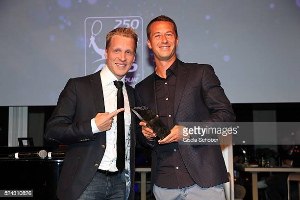 Oliver Pocher and tennis Player Philipp Kohlschreiber with award during the Players Night of the BMW Open 2016 tennis tournament at Iphitos tennis...