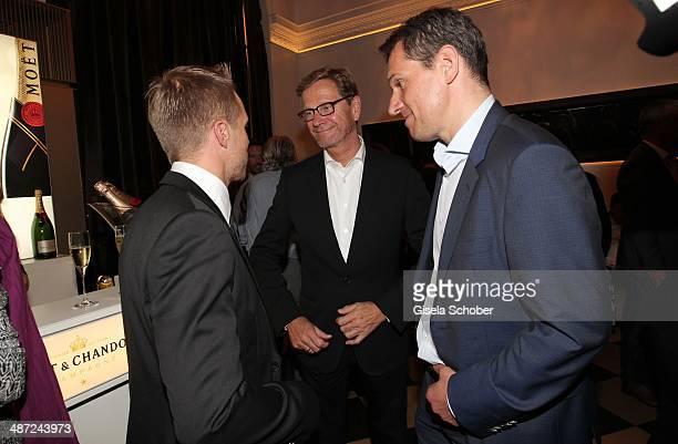 Oliver Pocher Guido Westerwelle and Michael Mronz attend the BMW Open Players Night at Rilano No 6 on April 28 2014 in Munich Germany