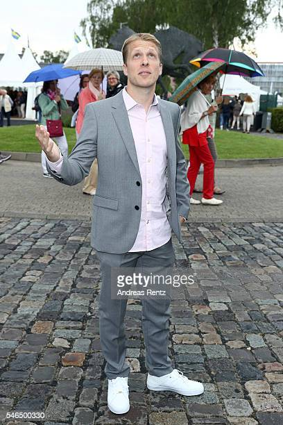 Oliver Pocher looks up to the sky to watch the rain as he arrives for the media night of the CHIO 2016 on July 12 2016 in Aachen Germany