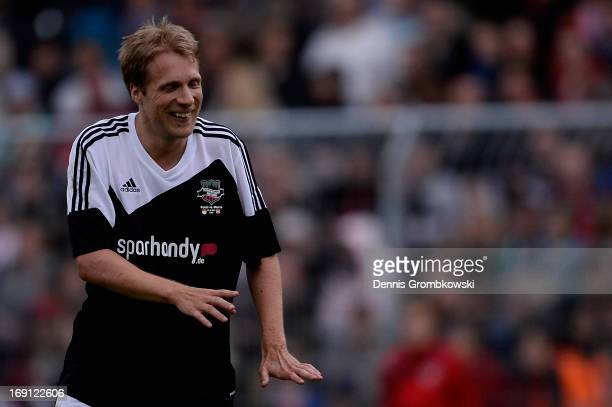 Oliver Pocher reacts during the 'Kicken fuer den guten Zweck' event at Sportpark Hoehenberg on May 20 2013 in Cologne Germany