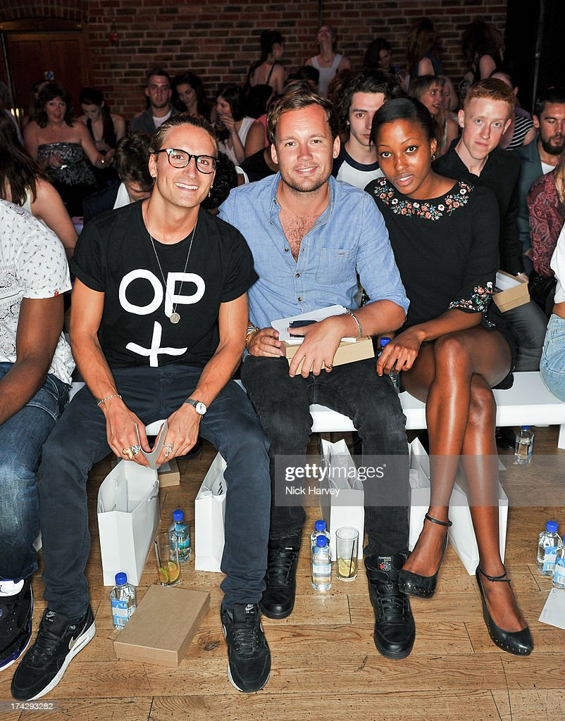Oliver Proudlock (L) and guests attend the UK contest final for the Elite Model Management: Elite Model Look at The Brewery on July 23, 2013 in London, England.