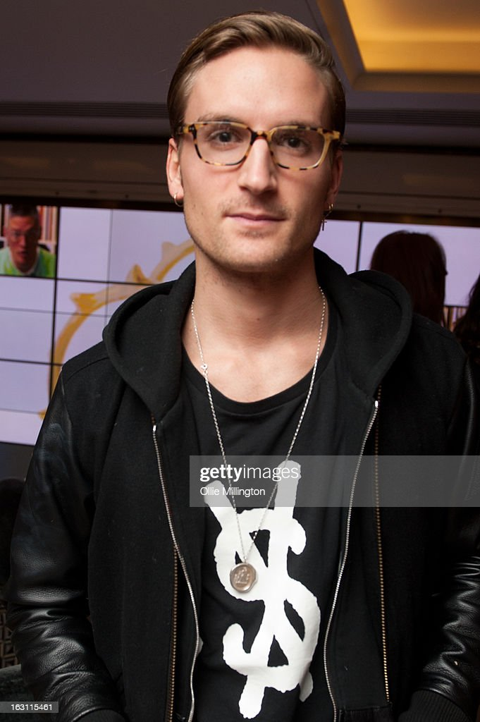 Oliver Proudlock attends as Giles Deacon launches his Libertine collection for QVC at The Club at The Ivy on March 4, 2013 in London, England.