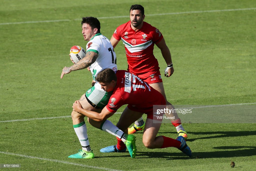 Oliver Roberts of Ireland is tackled by Ben Morris of Wales during the 2017 Rugby League World Cup match between Wales and Ireland at nib Stadium on November 12, 2017 in Perth, Australia.