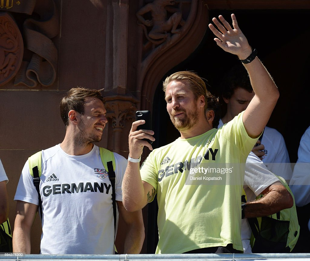 Oliver Roggisch and Kai Haefner celebrate during the German Olympic Team Welcome Home Reception on August 23 2016 in Frankfurt am MaIN GERMANY