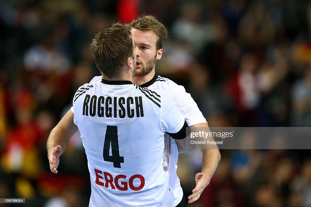 <a gi-track='captionPersonalityLinkClicked' href=/galleries/search?phrase=Oliver+Roggisch&family=editorial&specificpeople=577212 ng-click='$event.stopPropagation()'>Oliver Roggisch</a> and Kevin Schmidt of Germany celebrates the 28-23 victory during the round of sixteen match between Germany and Macedonia at Palau Sant Jordi on January 20, 2013 in Barcelona, Spain.