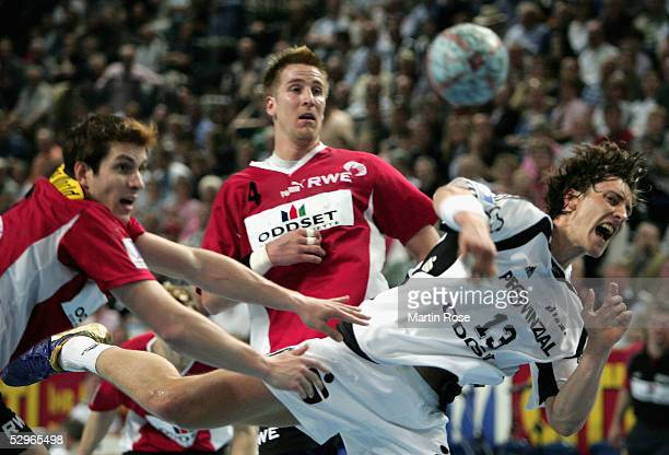 Oliver Roggisch and Michael Haass of Essen attacks Marcus Ahlm of Kiel during the Handball Bundesliga match between THW Kiel and TuSEM Essen at the...
