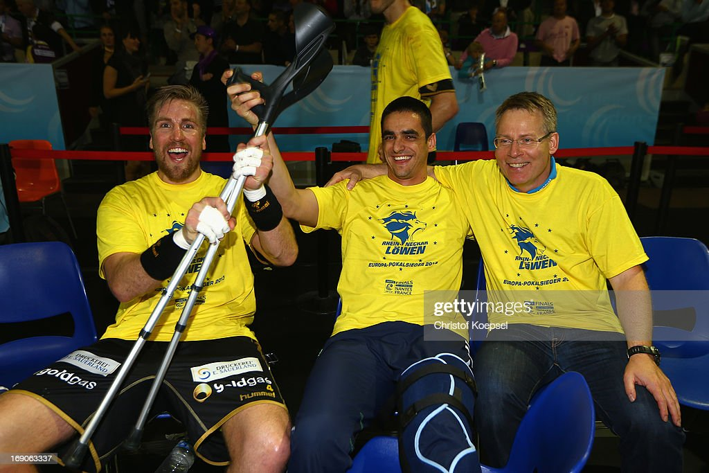 <a gi-track='captionPersonalityLinkClicked' href=/galleries/search?phrase=Oliver+Roggisch&family=editorial&specificpeople=577212 ng-click='$event.stopPropagation()'>Oliver Roggisch</a>, head coach Gudmundur Gudmundsson and <a gi-track='captionPersonalityLinkClicked' href=/galleries/search?phrase=Zarko+Sesum&family=editorial&specificpeople=5668700 ng-click='$event.stopPropagation()'>Zarko Sesum</a> of Rhein-Neckar Loewen celerate afetr winning the EHF Cup Final match between HBC Nantes and and Rhein-Neckar Loewen at Palais des Sports de Beaulieu on May 19, 2013 in Nantes, France.