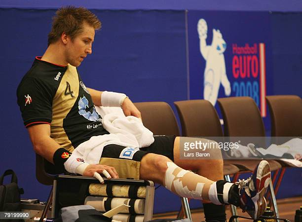 Oliver Roggisch of Germany sits injured on the bench during the Men's Handball European Championship main round Group II match between Germany and...