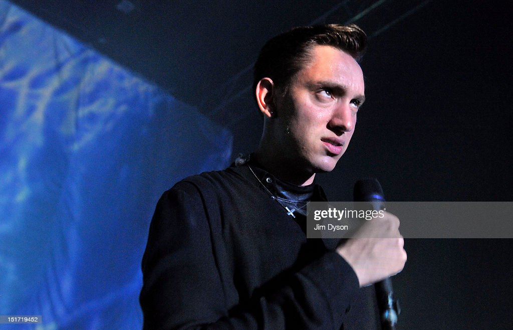 <a gi-track='captionPersonalityLinkClicked' href=/galleries/search?phrase=Oliver+Sim&family=editorial&specificpeople=6078321 ng-click='$event.stopPropagation()'>Oliver Sim</a> of The XX performs live on stage at Shepherds Bush Empire to support the release of their second album, Coexist, on September 10, 2012 in London, United Kingdom.