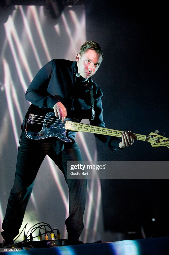 <a gi-track='captionPersonalityLinkClicked' href=/galleries/search?phrase=Oliver+Sim&family=editorial&specificpeople=6078321 ng-click='$event.stopPropagation()'>Oliver Sim</a> of The XX performs on stage during Electric Picnic on August 31, 2012 in Stradbally, Ireland.