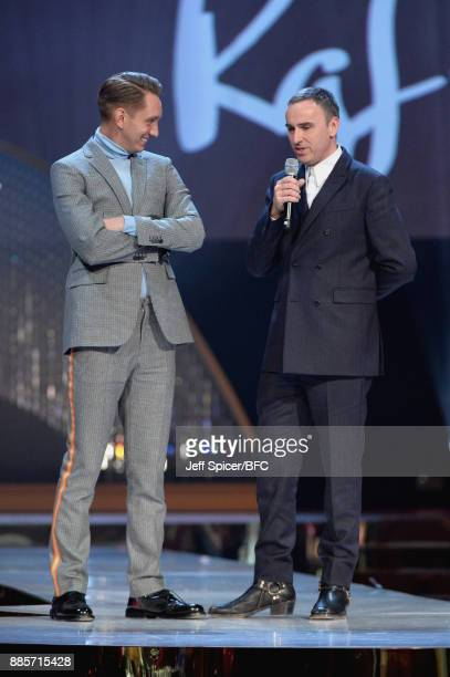 Oliver Sim presents Raf Simons with his award on stage during The Fashion Awards 2017 in partnership with Swarovski at Royal Albert Hall on December...