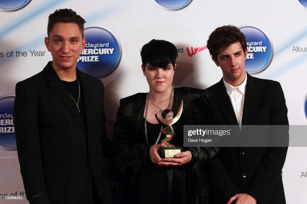 Oliver Sim Romy Madley Croft and Jamie Smith of The XX pose in front of the winners board at the Barclaycard Mercury Music Prize 2010 held at The...