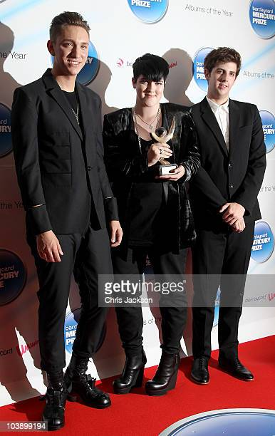 Oliver Sim Romy Madley Croft and Jamie Smith of The XX talk on stage after winning the Barclaycard Mercury Prize at the Grosvenor House Hotel on on...