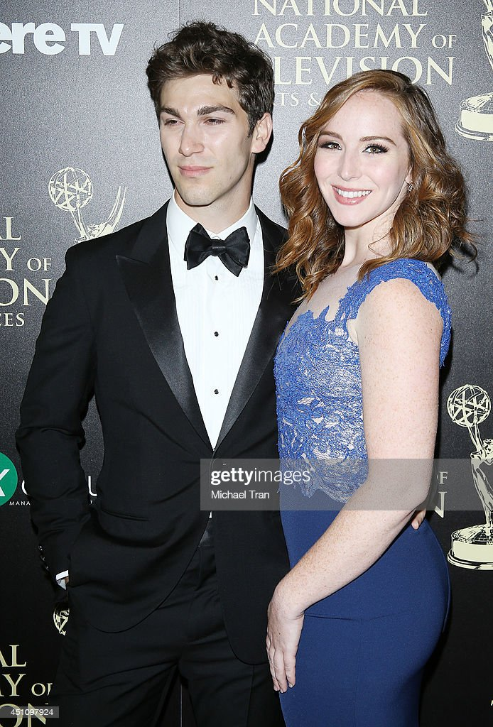 Oliver Singer and Camryn Grimes arrive at the 41st Annual Daytime Emmy Awards held at The Beverly Hilton Hotel on June 22 2014 in Beverly Hills...