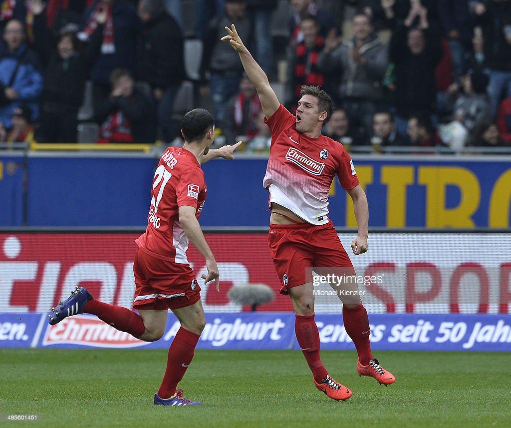 Oliver Sorg (R) of Freiburg celebrates his goal with Nicolas Hoefler (L) during the Bundesliga match between SC Freiburg and Borussia Moenchengladbach at Mage Solar Stadium on April 19, 2014 in Freiburg, Germany.